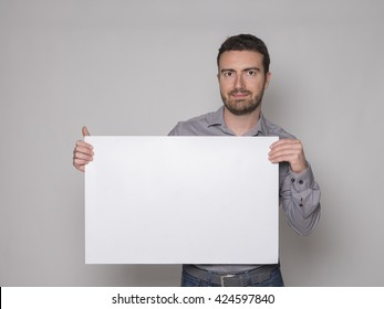 man with white banner cardboard isolated on gray background