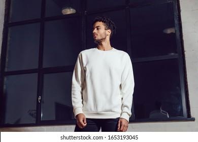 Man in white blank sweatshirt. Mock-up.