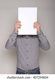 man with a white cardboard hiding his face and copy space for text