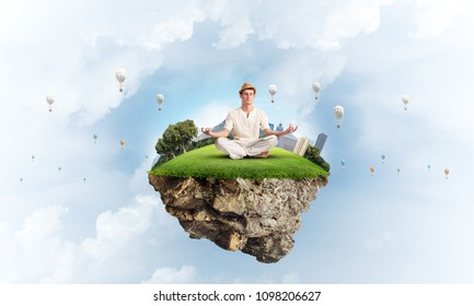 Man in white clothing keeping eyes closed and looking concentrated while meditating on flying island with cloudy skyscape and flying aerostats on background. 3D rendering.