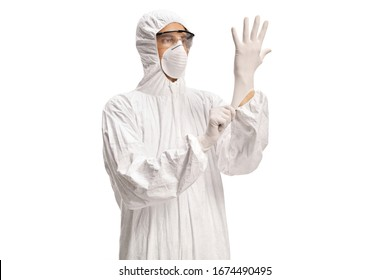 Man in a white decontamination suit putting on medical gloves isolated on white background