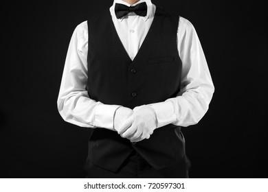 Man in white gloves on black background