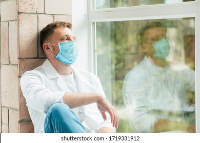 Man in white protective suit, mask, coronavirus pandemic threat. Epidemic, pandemic of coronavirus covid 19. Doctor, patient in respirator.