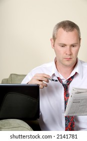 man with white shirt reading a newspaper