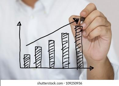 Man in white shirt sketching success graph