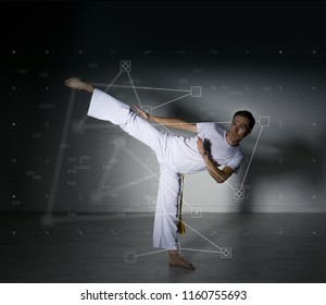 Man in white sportswear performing a kick. Sport science, biomechanics, information technology concept.