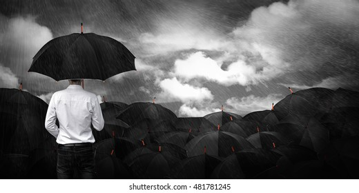 Man in white standing umbrella business concept.