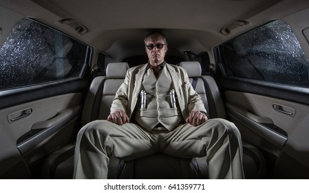 Man in a white suit with a gun, ganster, mafia in the car