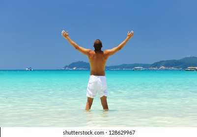 Man in white at tropical beach