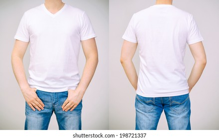 Man in white t-shirt. Grey background.