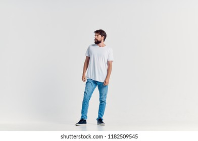 man in a white T-shirt and jeans
