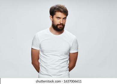 a man in a white T-shirt short haircut model cropped view