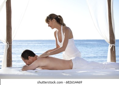 Man who gets massaged on the beach