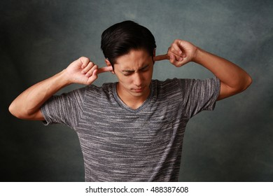 Man who holds his ears