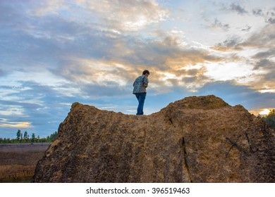 A man who look the sky view on the cliff