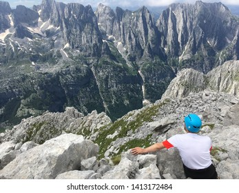 A man who looks at the peaks of Prokletije in Albania
