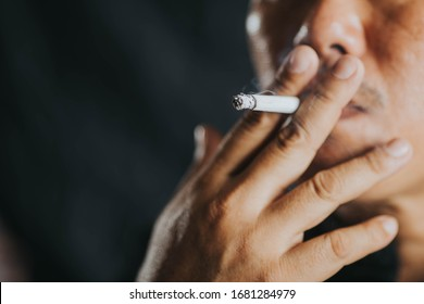 A man who is smoking