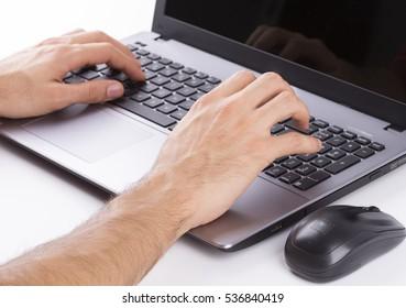 Man who writes on a computer