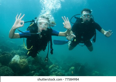 man and wife scuba dive together