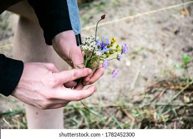 Man with wild flower bouquet.