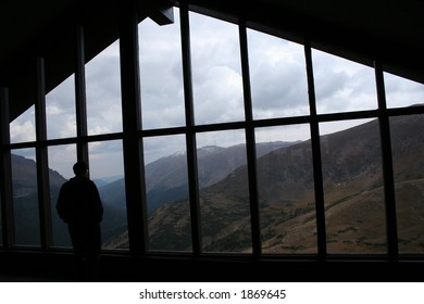 man in window at alpine visitor center in rocky mountain national park, colorado