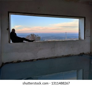 man in the windows of deserted building