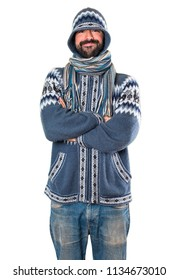 Man with winter clothes with his arms crossed