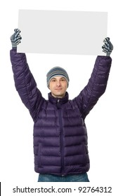 man in man winter clothes holding a big blank card