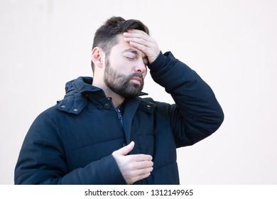 man in winter with headache