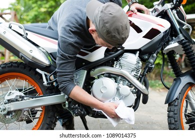 Man wiping the motorcycle