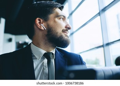 man with wireless earpiece
