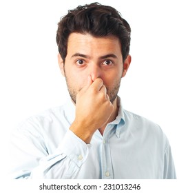 man without smell gesture on a white background