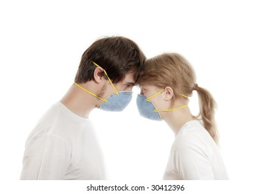 Man and woman 20-35 years  in blue face masks  with heads together  against white background