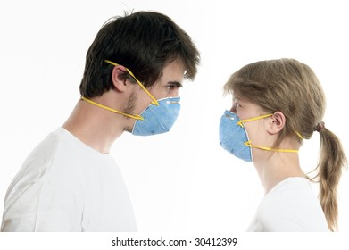 Man and woman 20-35 years  in blue respirators face to face against white background