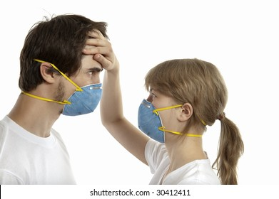Man and woman 20-35 years  in  respirators face to face against white background