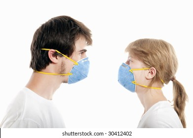 Man and woman 20-35 years  wearing  blue face masks  and looking one to another