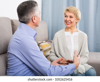Man and woman 50-54 years old love friendly talk and warm embraces.