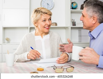 Man and woman 50-54 years old are lead discussion about agreement of the credit.