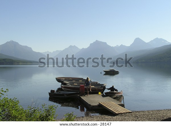 man and woman abroad the MacDonald lake on early morning  in  West Glacier national Park, Montana