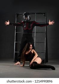 Man and woman acting erotic bdsm perfomance shot