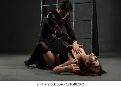 Man and woman acting erotic bdsm perfomance