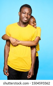 man and woman of african appearance yellow t-shirts friendship relations all together