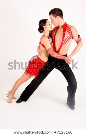 af7ee3d33cb13 Man and woman ballroom dancers in exotic costumes performing before a white  background