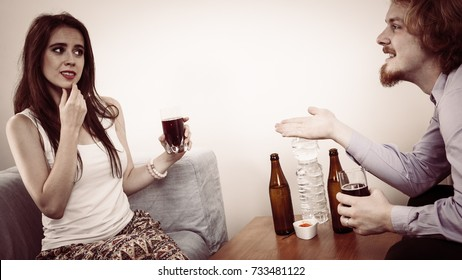 Man and woman being on worst date ever. Female being displeased by meeting with weird guy not expecting pizza and beer.