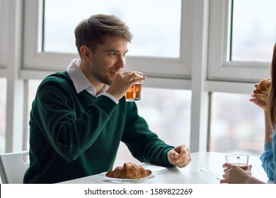 Man and woman in cafe chatting dating breakfast - Shutterstock ID 1589822269