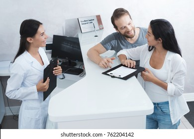 A man and a woman came to see a dentist. They fill in the necessary papers in the waiting room. There they were met by the secretary of the dental clinic.