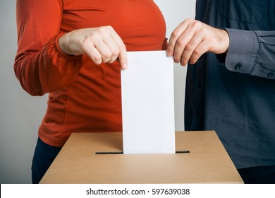 Man And Woman Casting Their Vote