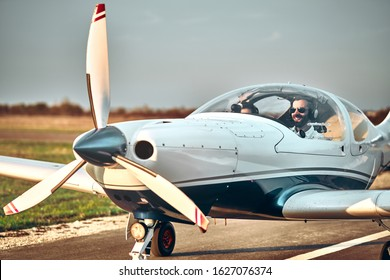 Man and woman in the cockpit of a light aircraft. Ready take off