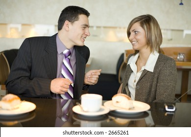 Man and Woman at Cofe Table. Short Depth of Focus (On Their Faces).