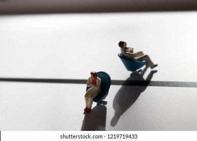 Man and woman in conflict. Divided or divorced couple. Two people in need of therapy or counselling. Male and female disagreement or argument. Division or separation between the genders with shadows.